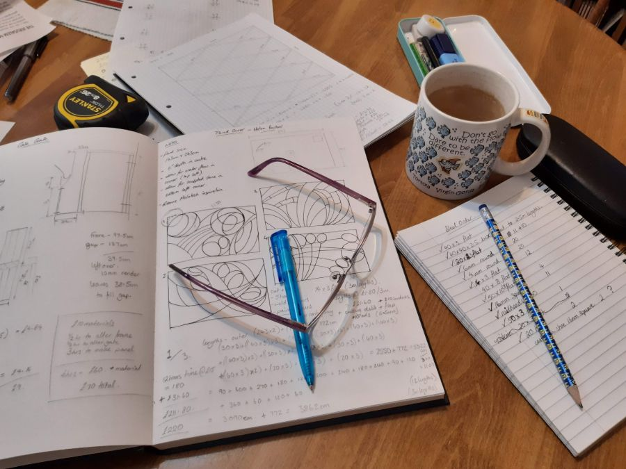 design workspace paper and pencil and cup of ea